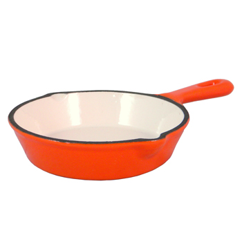 Orange enameled cast iron skillet